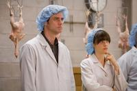 Jim Carrey as Carl and Zooey Deschanel as Allison in