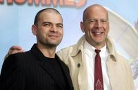 Clovis Cornillac and Bruce Willis at the premiere of