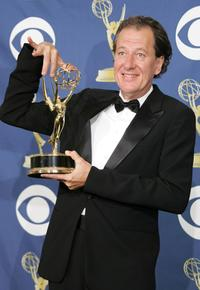 Geoffrey Rush in the press room at the 57th Annual Emmy Awards.