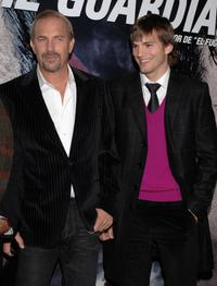 Kevin Costner and Ashton Kutcher at the premiere of