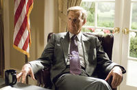 James Cromwell as George H. W. Bush in