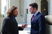 Russell Crowe as Cal McCaffrey and Ben Affleck as Stephen Collins in
