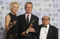 Danny Devito and Michael Douglas with Sharon Stone at the 61st Golden Globe awards.