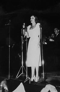 Marlene Dietrich performs at the stage of Paris Opera.