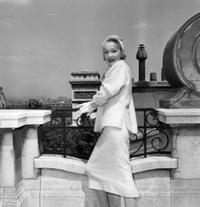 Marlene Dietrich poses for a photo in Paris.