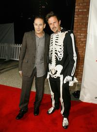 David Arquette and Paul Reubens pose for photographers at the DVD release party for the