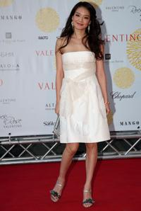 Shu Qi at the Ara Pacis for Valentino's Exhibition opening.
