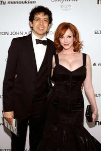 Geoffrey Arend and Christina Hendricks at the 18th Annual Elton John AIDS Foundation Academy Awards Party.