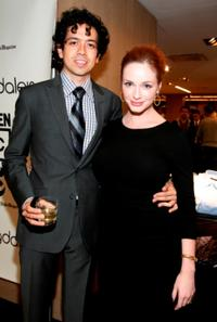 Geoffrey Arend and Christina Hendricks at the Bloomingdale's men's floor re-opening celebration.