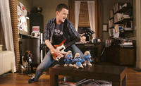 Neil Patrick Harris as Patrick, Gutsy, Brainy and Grouchy Smurf in
