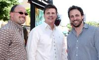 Cary Granat, Michael Lewis and Seth Meyers at the premiere of