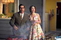 Eric McCormack as Ted Lewis and Jody Thompson as Lana in