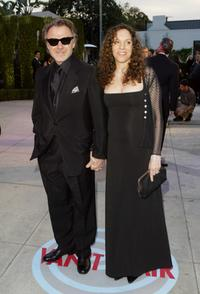 Harvey Keitel and a guest attend The 2004 Vanity Fair Oscar Party.