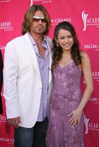Billy Ray Cyrus and daughter Miley Cyrus at the 41st Annual Academy of Country Music Awards.