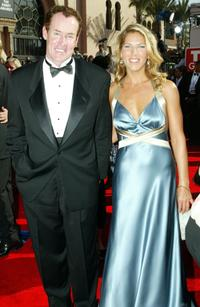 John C. McGinley and guest arrives at the 57th Annual Emmy Awards.