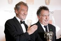 Sir Ian McKellen and Stephen Frears at the Orange British Academy Film Awards pose with the Best Film Award for