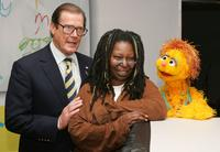 Roger Moore, Whoopi Goldberg and Kami the HIV positive muppet at the UNICEF and Clear Channel ad campaign.