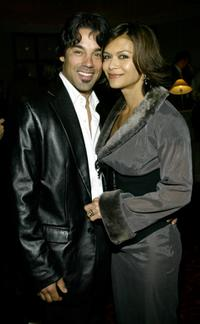 Nia Peeples and her husband at the Annual Norby Walters Holliday Party.