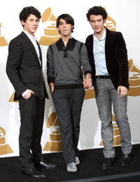 Nick Jonas, Joe Jonas and Kevin Jonas at the press room during the Grammy Nominations concert live.