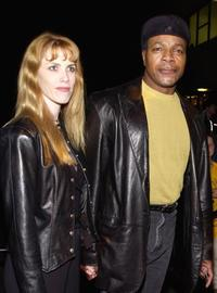 Carl Weathers and Guest at the Ultimate Celebrity Super Bowl Bash.