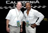Carl Weathers and David Koechner pose at the NASCAR Nextel Cup Series Sharp Aquos 500.