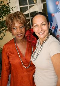Alfre Woodard and Turia Spector pose Robert Wan Tahiti jewelry and skin care booth during the Frederic Fekkai Pre-Emmy