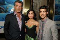 Pierce Brosnan, Demi Lovato and Joe Jonas at the premiere of