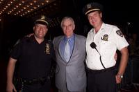 Charlton Hestonand and two New York City Police officers at the premiere of