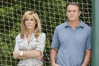 Sandra Bullock as Leigh Anne Tuohy and Tim Mcgraw as Sean Tuohy in