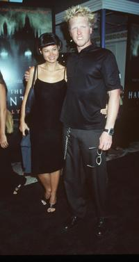 Jake Busey and date at the premiere of