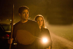 "Jesse Metcalfe as Craig Landry and Erika Christensen as Elise Landry in ""The Tortured."""