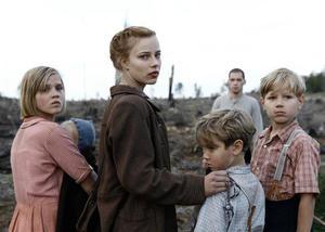 "Nele Trebs as Liesel, Saskia Rosendahl as Lore, Mika Seidel as Jurgen and Andre Frid as Gunther in ""Lore."""