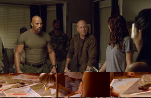 "Dwayne Johnson as Roadblock and Bruce Willis as Colton in ""G.I. Joe: Retaliation 3D."""