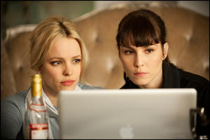 "Rachel McAdams as Christine and Noomi Rapace as Isabelle in ""Passion."""