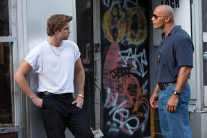 "Liam Hemsworth as Chris Potamitis and Dwayne Johnson as James Ransome in ""Empire State."""