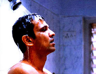 Rakesh Maria (Kay Kay Menon), an investigating police officer, in