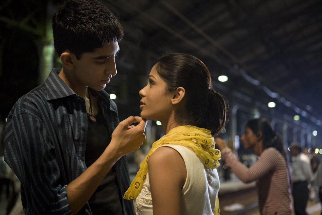 Dev Patel as Jamal and Freida Pinto as Latika in