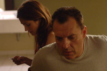 Tom Sizemore as Price and Sasha Alexander as Sarah in