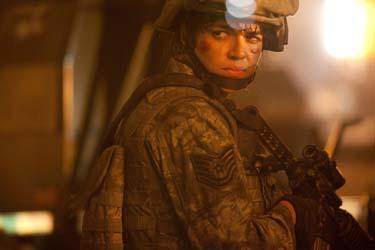Michelle Rodriguez as Corporal Adriana Santos in