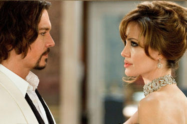 Angelina Jolie as Elise and Johnny Depp as Frank in