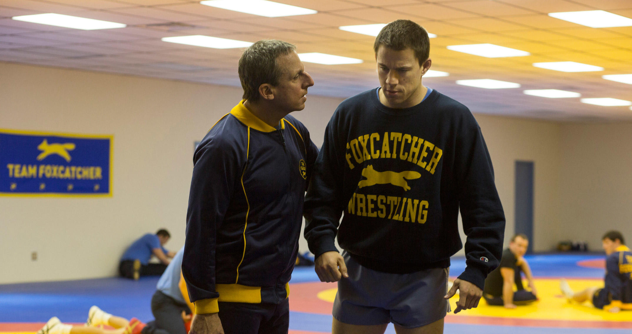 Steve Carell as John du Pont and Channing Tatum as Mark Schultz in