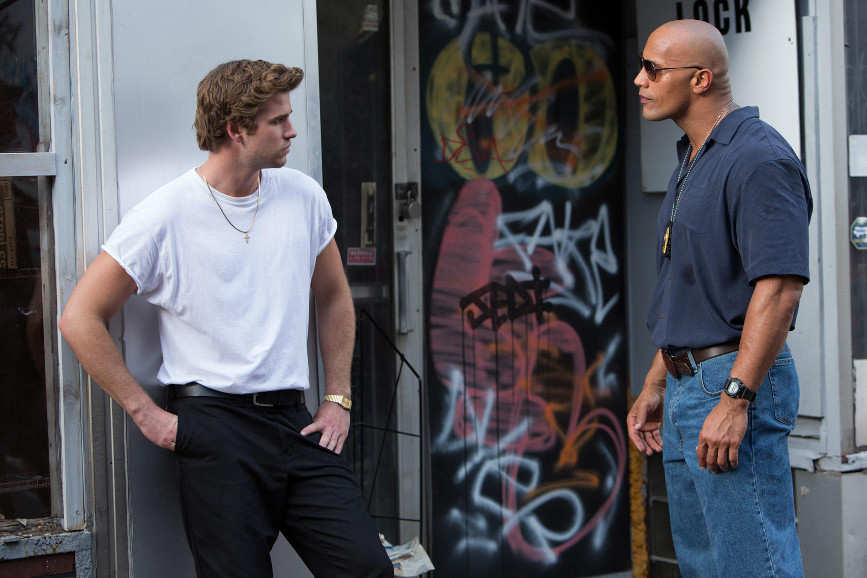 Liam Hemsworth as Chris Potamitis and Dwayne Johnson as James Ransome in