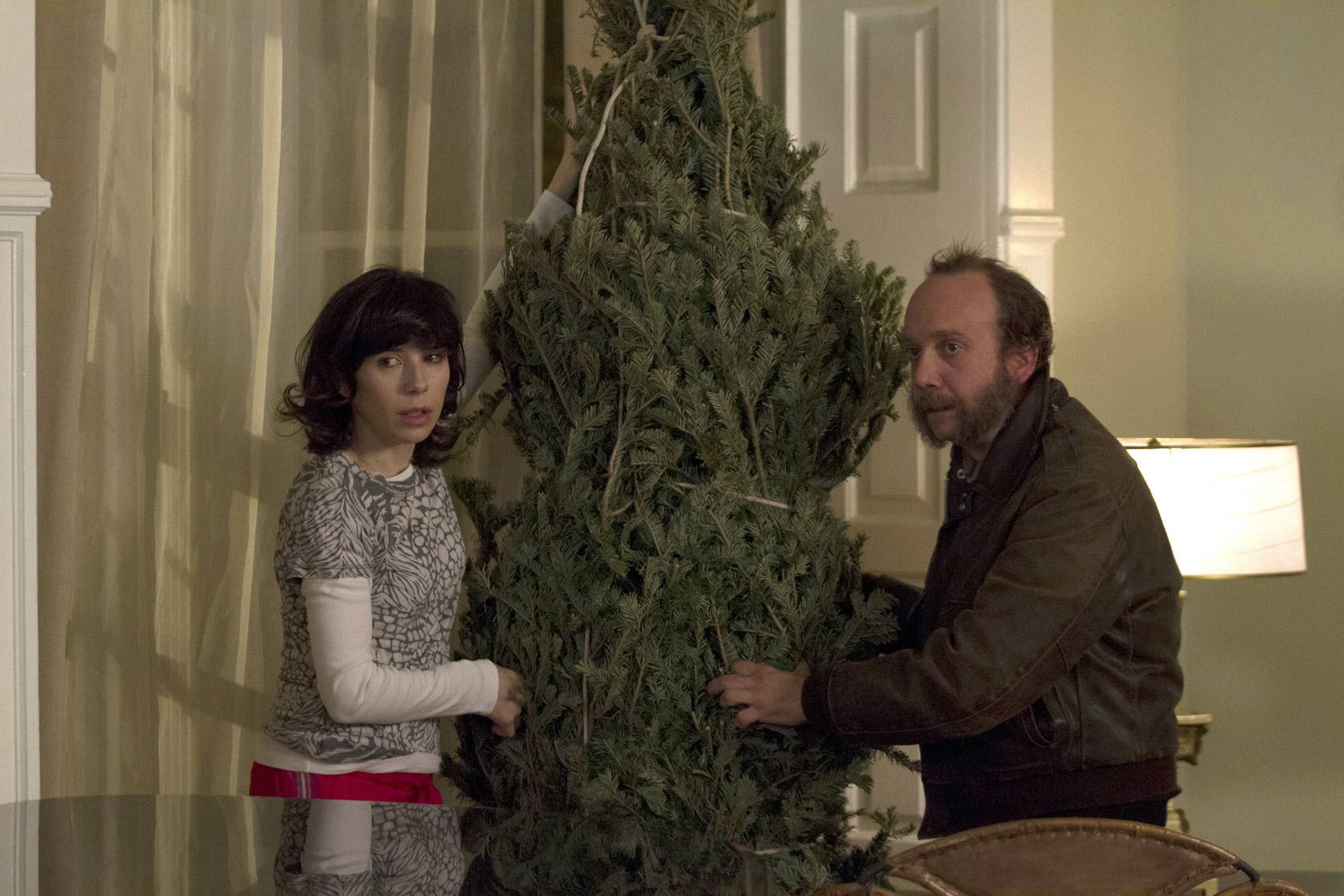 Paul Giamatti as Denis and Sally Hawkins as Olga in