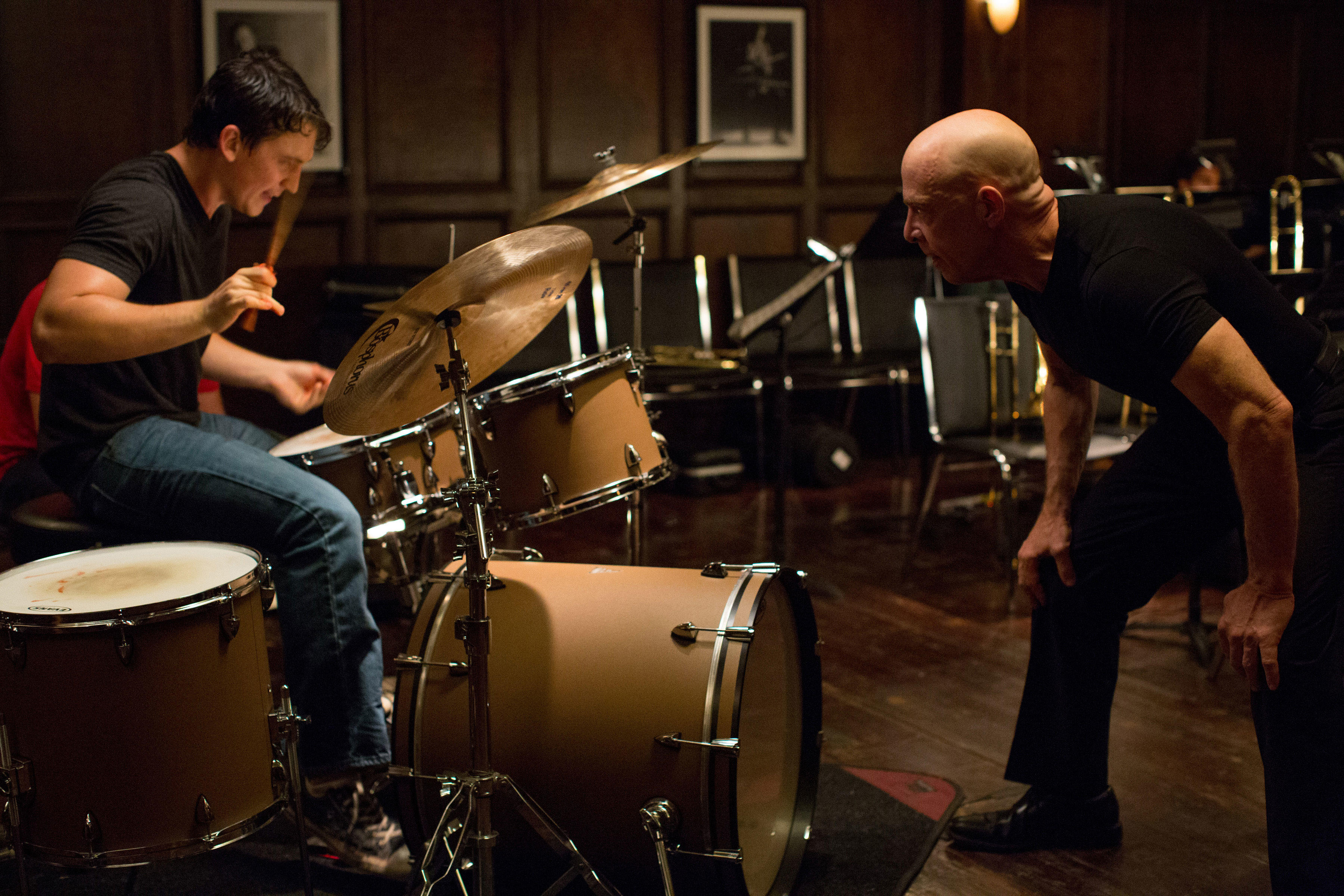 Miles Teller as Andrew and J.K. Simmons as Fletcher in
