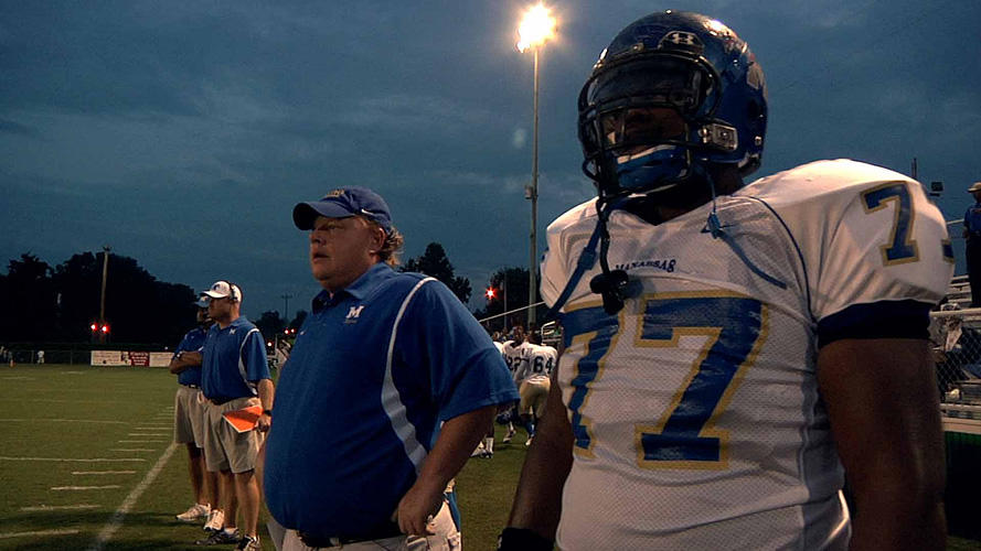 Coach Bill Courtney and O.C. Brown in
