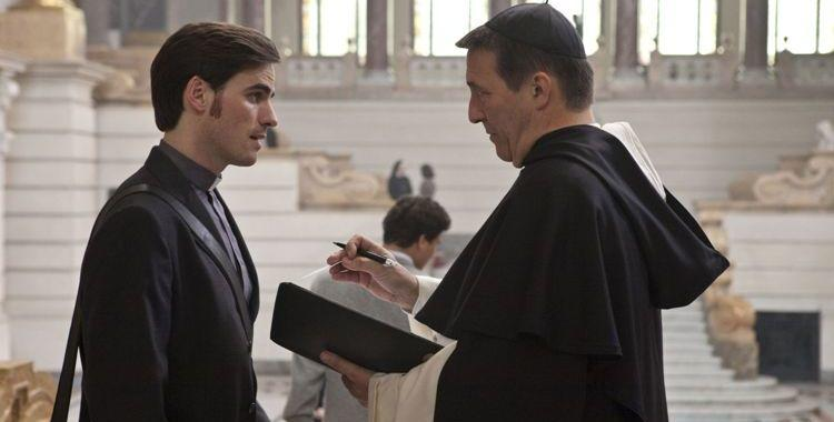 Colin O'Donoghue as Michael Kovak and Ciaran Hinds as Father Xavier in