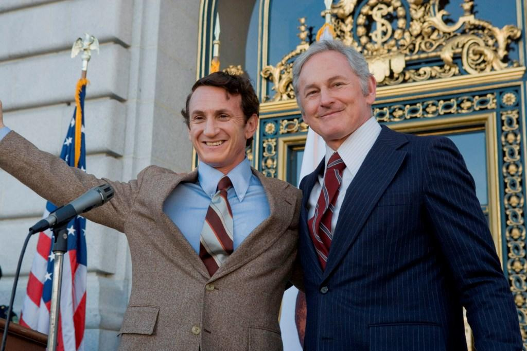 Sean Penn as Harvey Milk and Victor Garber as George Moscone in