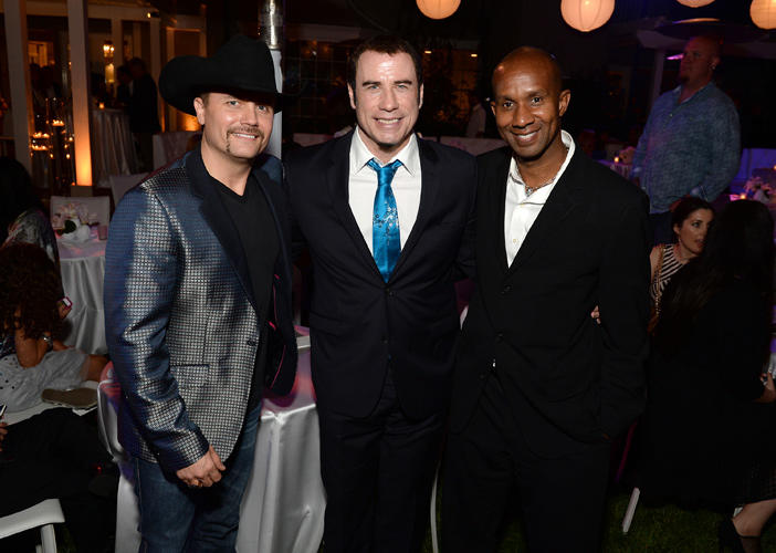 Musician John Rich, John Travolta and Alex Avant at the 87th Birthday celebration of Tony Bennett and Fundraiser for Exploring the Arts.