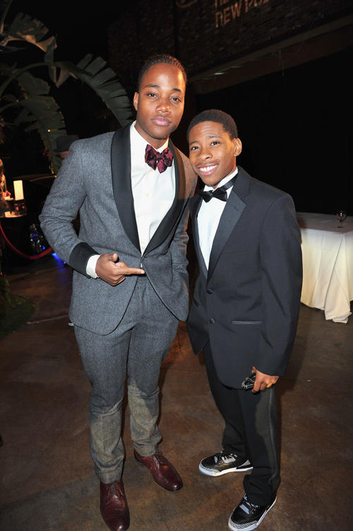 Leon Thomas III and Guest at the 43rd NAACP Image Awards in California.
