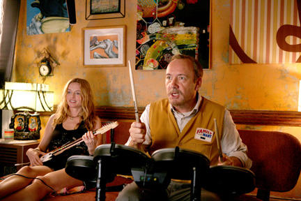 Heather Graham as Phoebe and Kevin Spacey as Robert Axle in ``Father of Invention.''